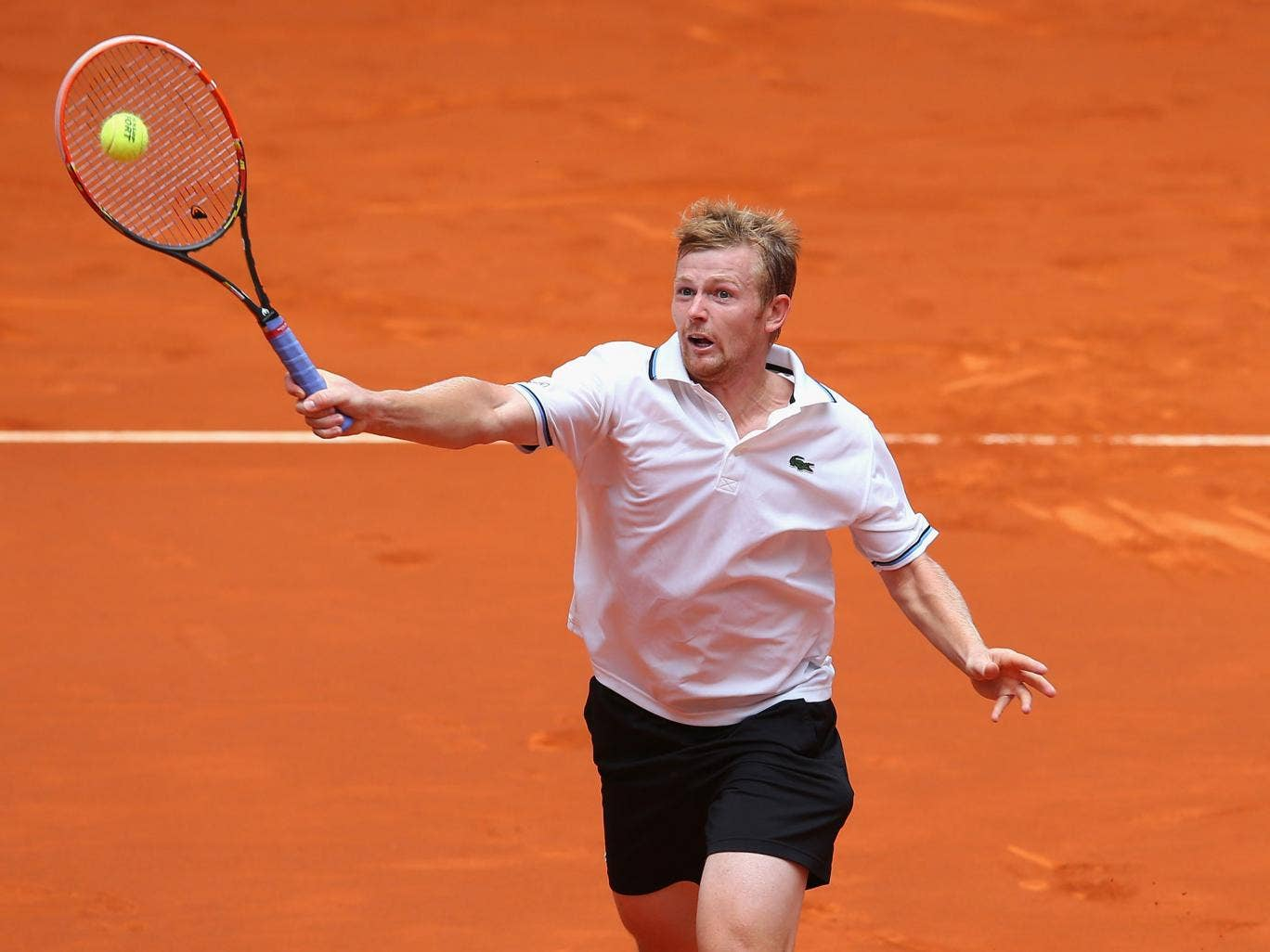 Andrey Golubev plays a volley at the Madrid Open earlier this month