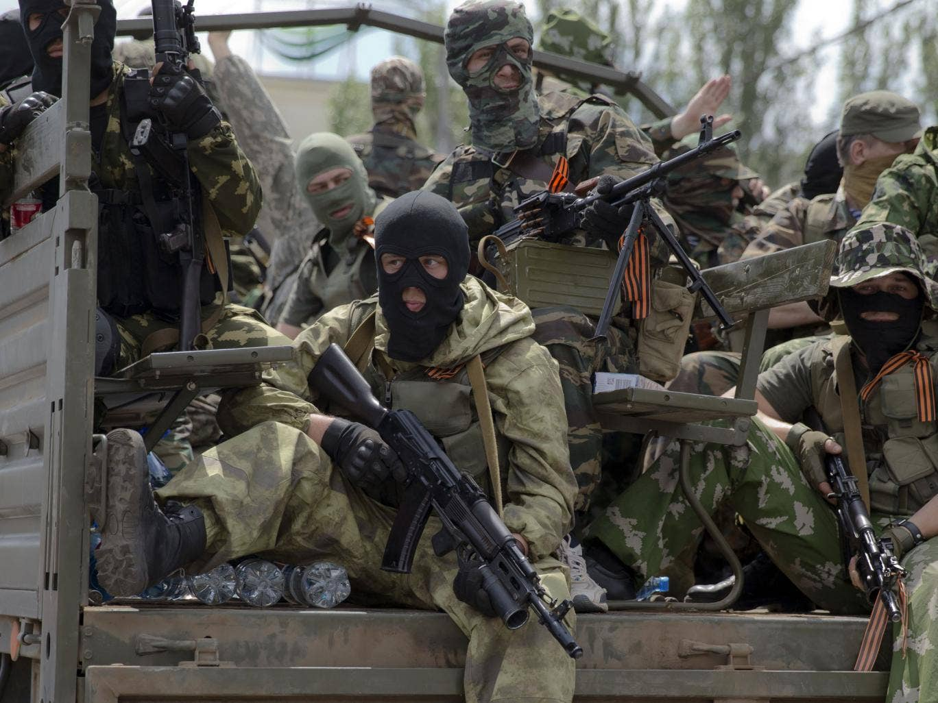 Pro-Russians ride on a truck in Donetsk. A convoy of an armored personnel carrier and seven trucks carrying several hundred heavily armed men drove through central Donetsk and gunmen got out of the trucks, stood to attention and gave shots in the air in j