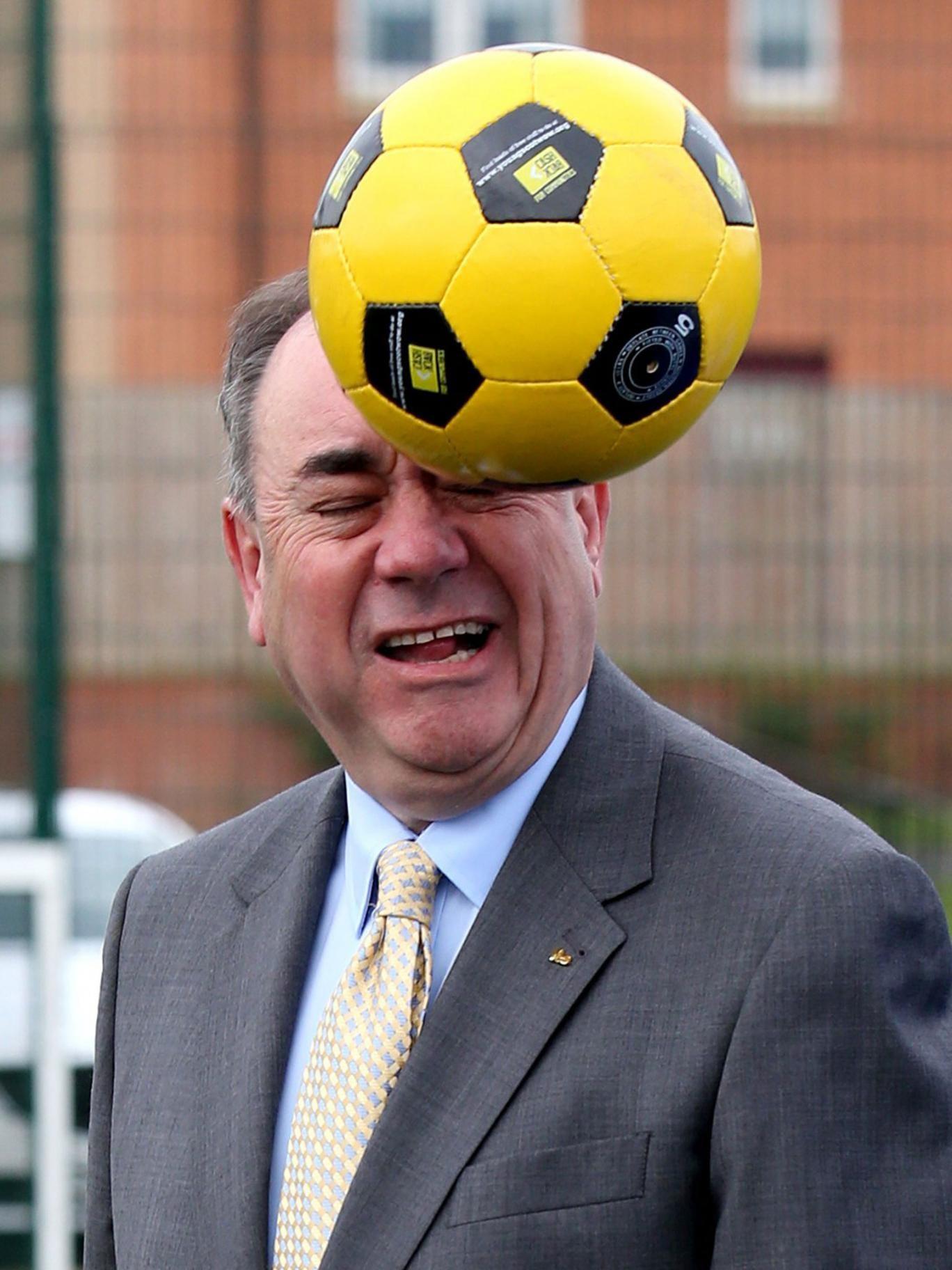 Alex Salmond heads a ball