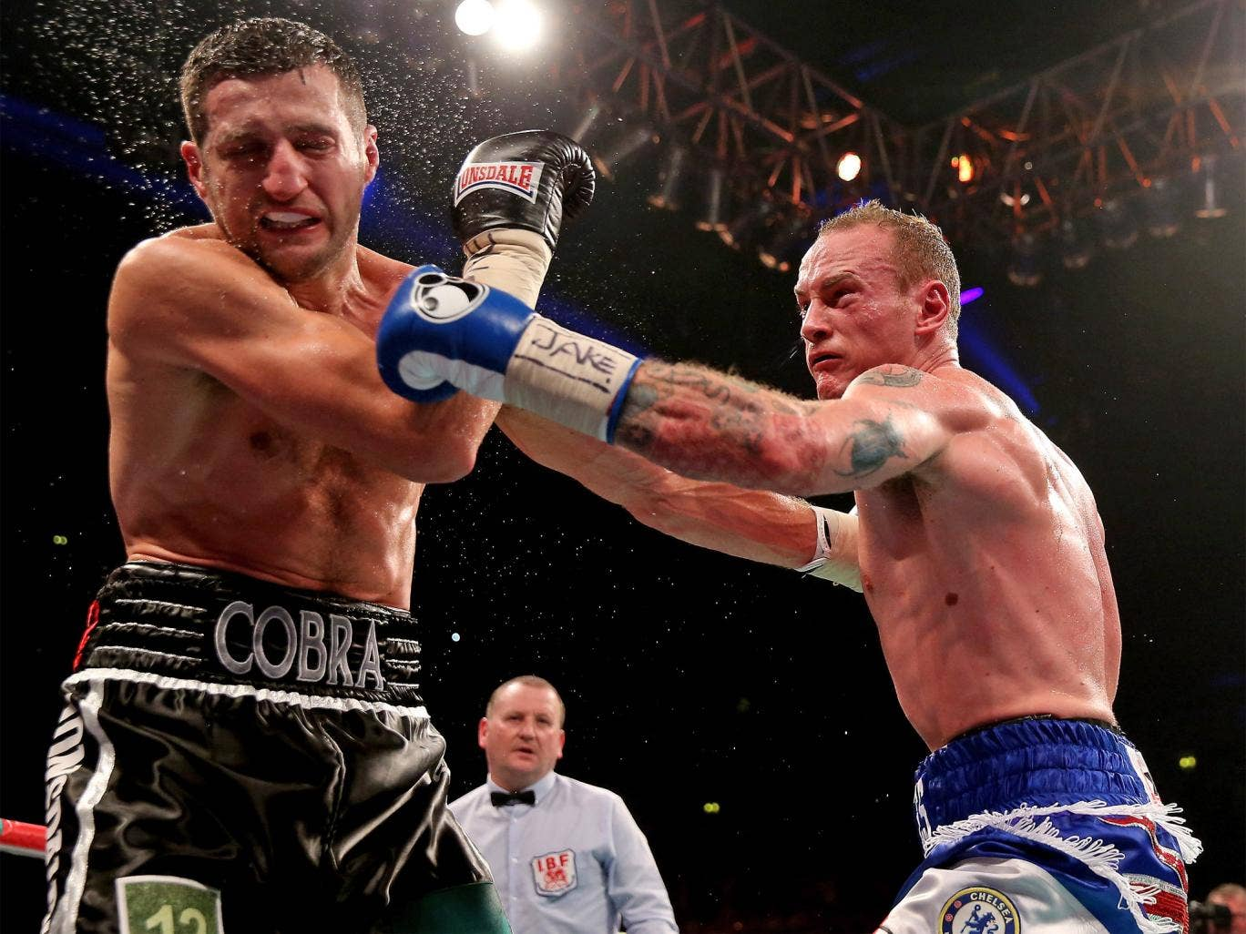 George Groves lands a stiff left on Carl Froch's chin during their controversial first fight
