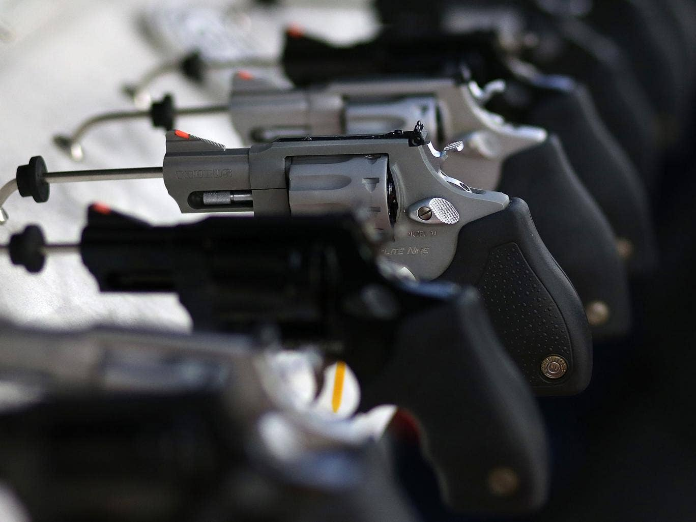 Handguns are displayed during the 2013 NRA Annual Meeting and Exhibits at the George R. Brown Convention Center on May 4, 2013 in Houston, Texas. More than 70,000 peope are expected to attend the NRA's 3-day annual meeting that features nearly 550 exhibit