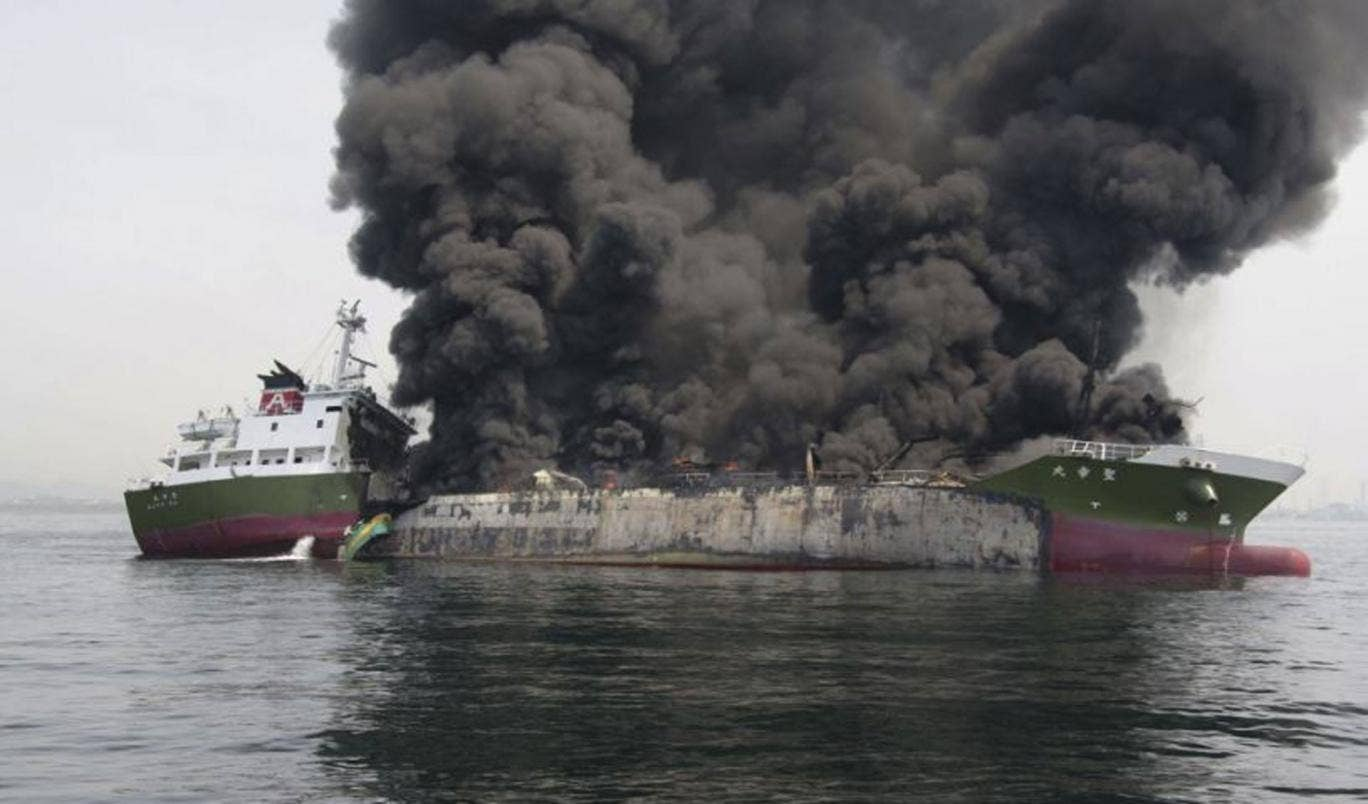 This photo, released by Japan's 5th Regional Coast Guard, shows clouds of black smoke billowing from the 998-tonne Shoko Maru, after it exploded off the southwest coast near Himeji port