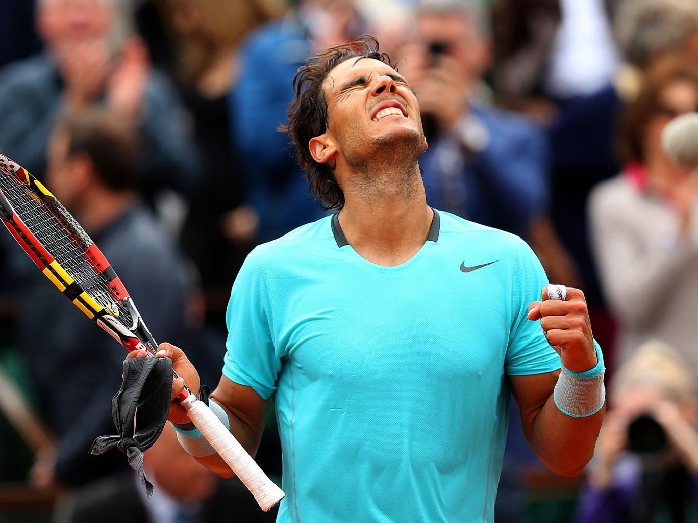 Rafael Nadal of Spain celebrates victory in his men's singles match against Dominic Thiem of Austria