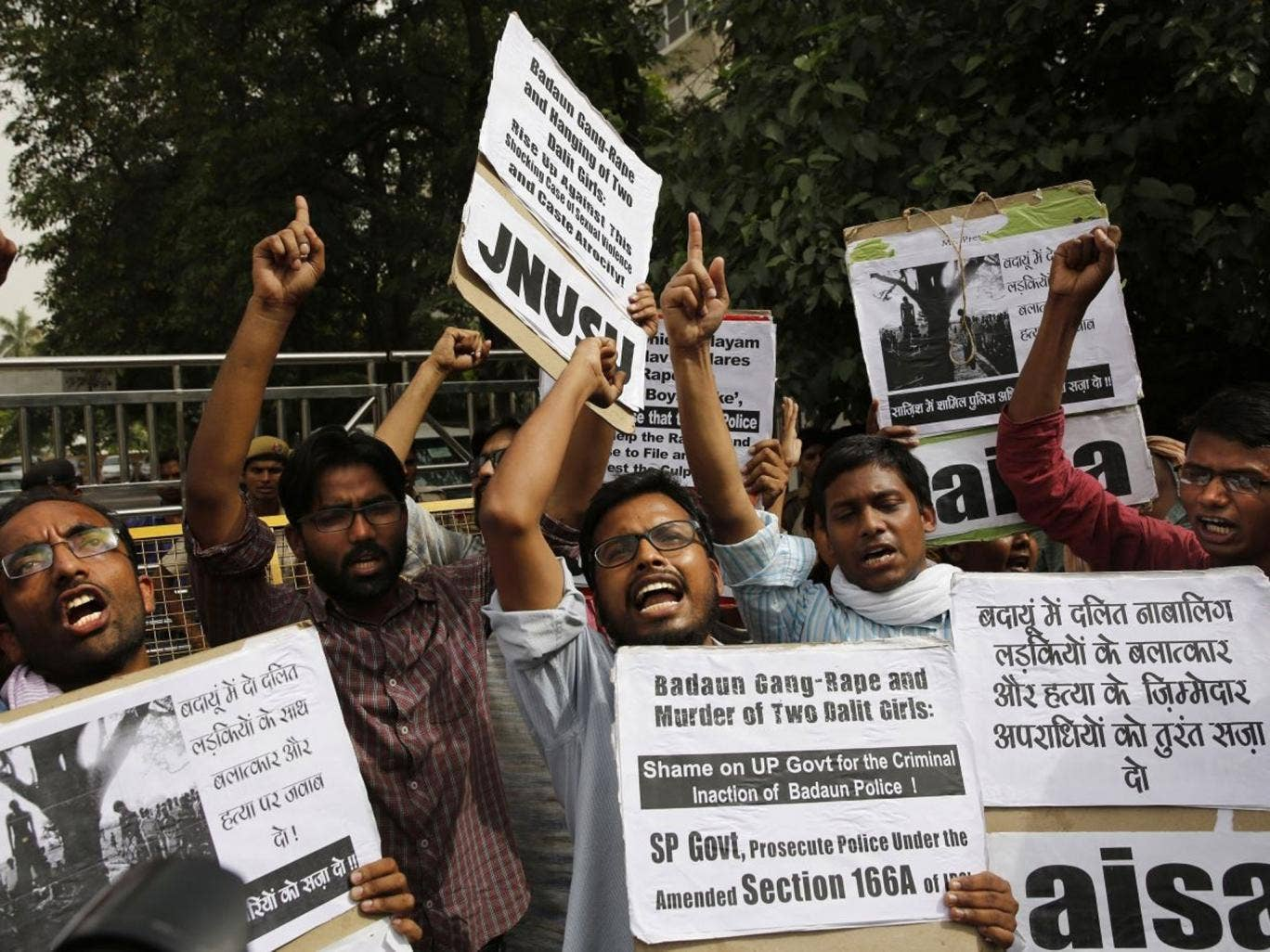 Members of Jawaharlal Nehru University Students Union shout slogans during a protest against a gang rape of two teenage girls in Katra village, outside the Uttar Pradesh state house, in New Delhi, India, Friday, May 30, 2014. A top government official sai