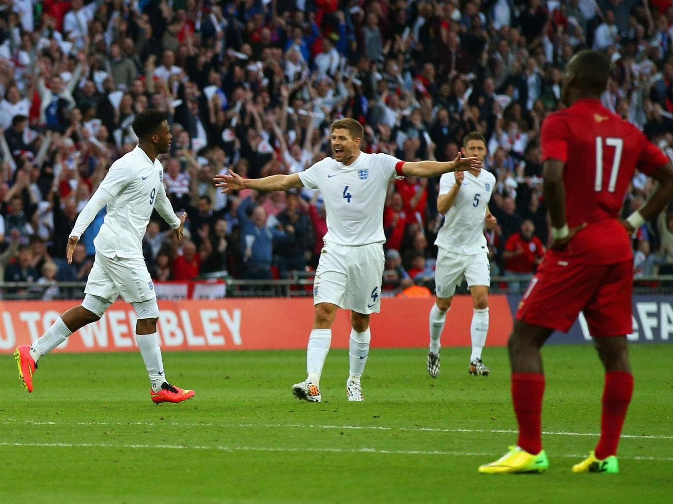 Steven Gerrard of England congratulates Daniel Sturridge of England on scoring the opening goal