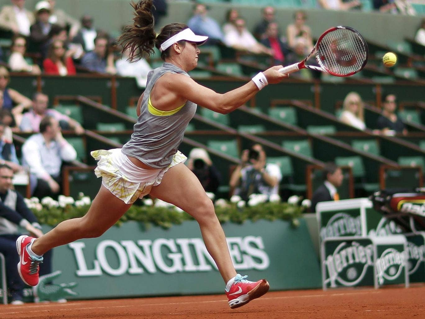 The 21-year-old Croat Ajla Tomljanovic on her way to victory over world No 3 Agnieszka Radwanska at Roland Garros yesterday as the new generation in women's tennis continues to make its mark in Paris
