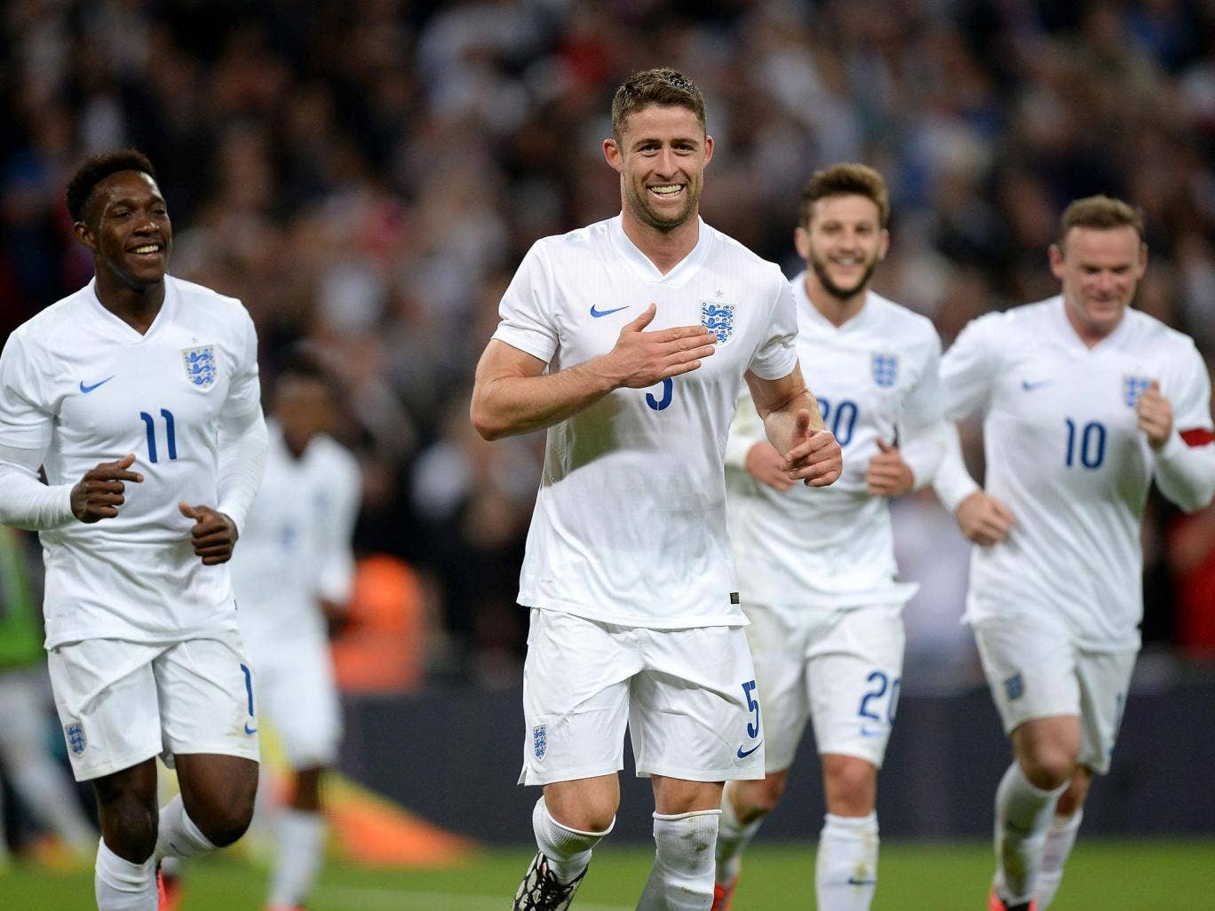 Gary Cahill (left) celebrates after putting England 2-0 up against Peru at Wembley last night. They went on to win 3-0 in their last game before heading to the United States