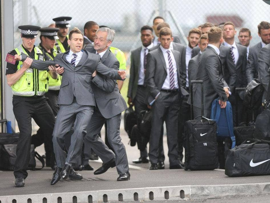 COMEDIAN SIMON BRODKIN BEING TAKEN AWAY BY POLICE AFTER GETTING PAST  SECURITY AND TALKING TO THE ENGLAND TEAM