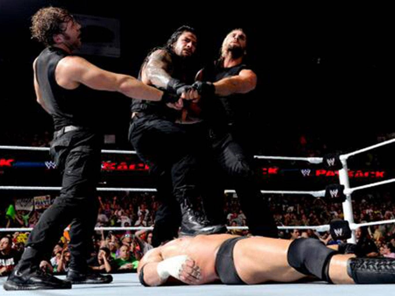 The Shield celebrate their victory over Evolution at Payback