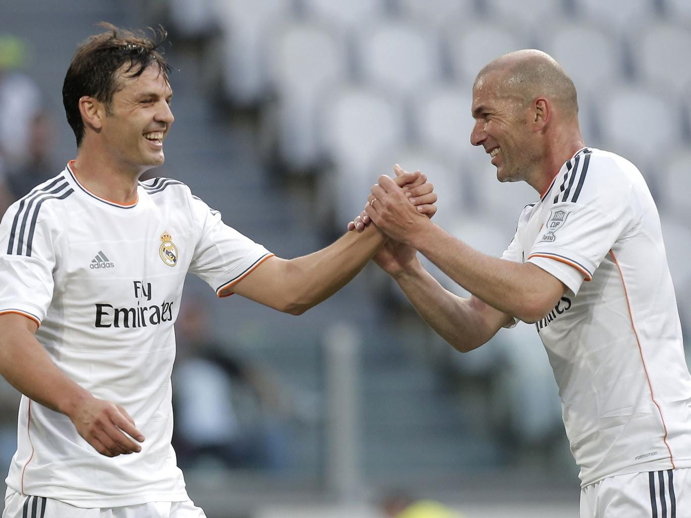Real Madrid's forward Sanchez Fernando Morientes (L) celebrates with his teammate Zinedine Zidane after scoring during the Unesco Cup football match Juventus Legends vs Real Madrid Leyendas