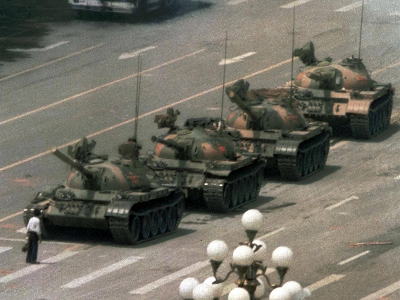 A celebrated image of a man trying to stop the tanks entering the square