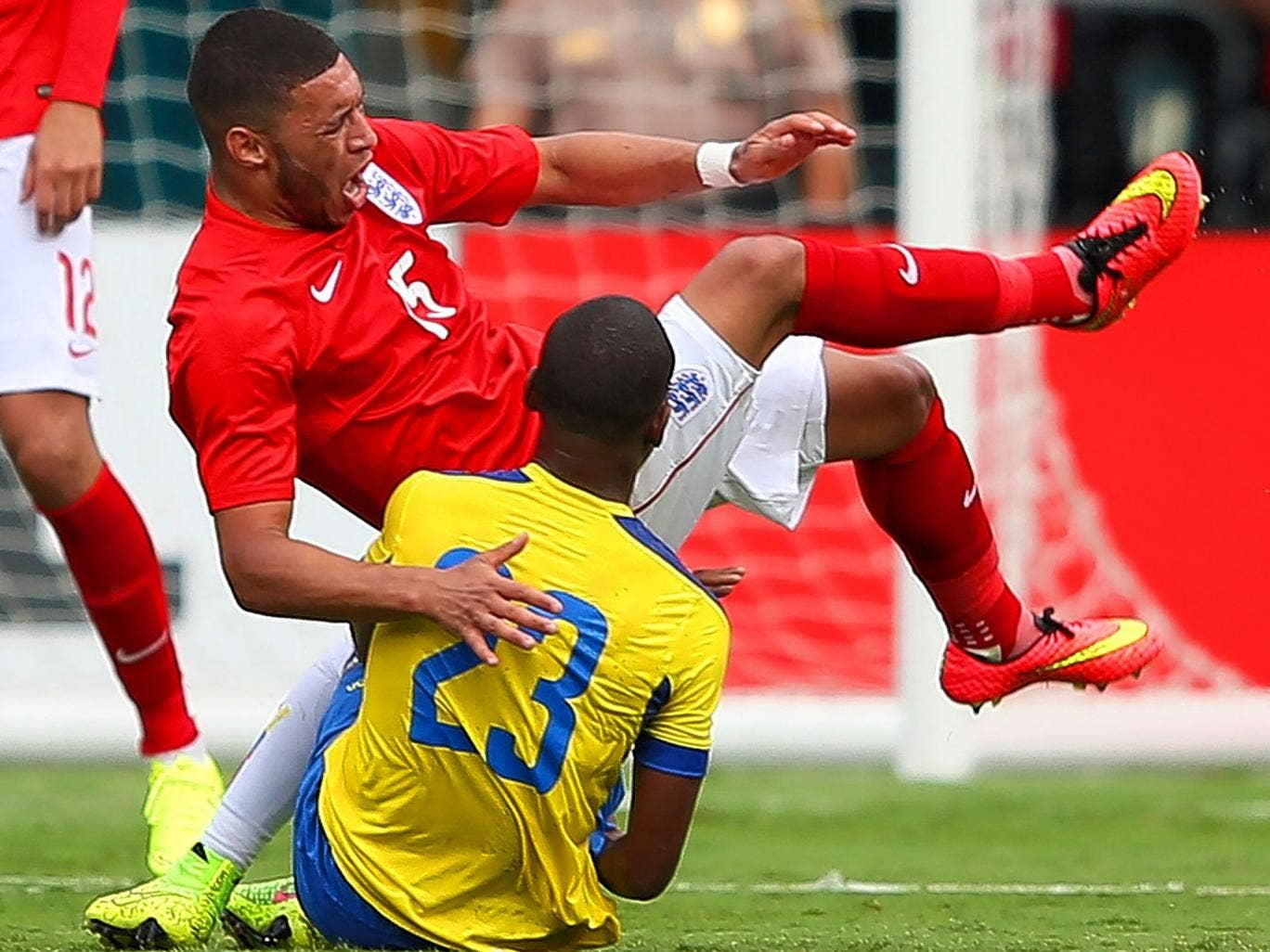 Alex Oxlade-Chamberlain goes down in pain under a challenge from Carlos Gruezo at the Sun Life Stadium in Miami yesterday