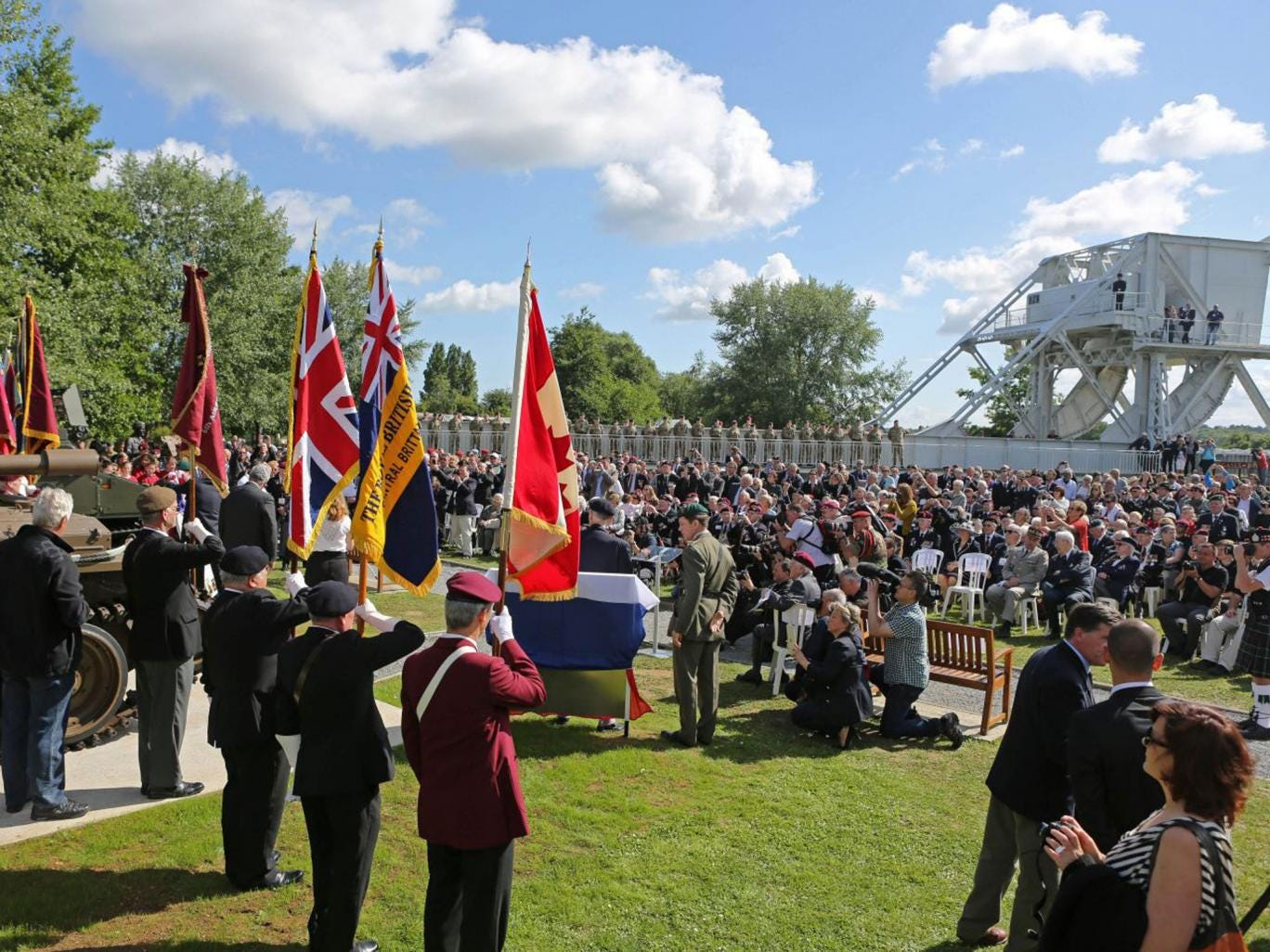 A remembrance ceremony is held at Pegasus Bridge memorial in Benouville western France, Thursday June 5, 2014,
