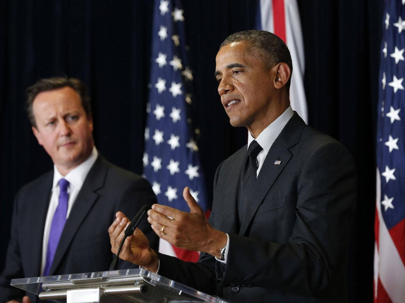 US President Barack Obama speaks next to David Cameron at a joint news conference after their meeting at the G7 summit in Brussels