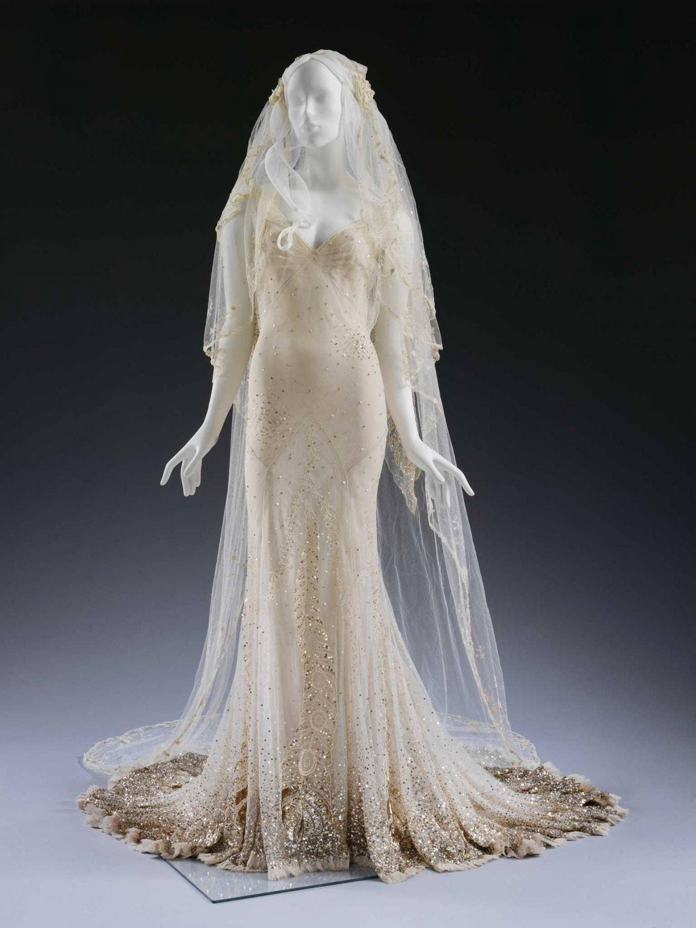 Kate's gown is embellished with golden paillette embroidery, a delicate couture touch reminiscent of John Galliano's work as head of Christian Dior