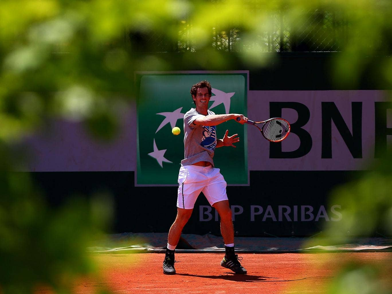 Andy Murray returns a shot during a practice session at Roland Garros yesterday, hoping to deny the world No 1 Rafa Nadal a ninth French Open final place