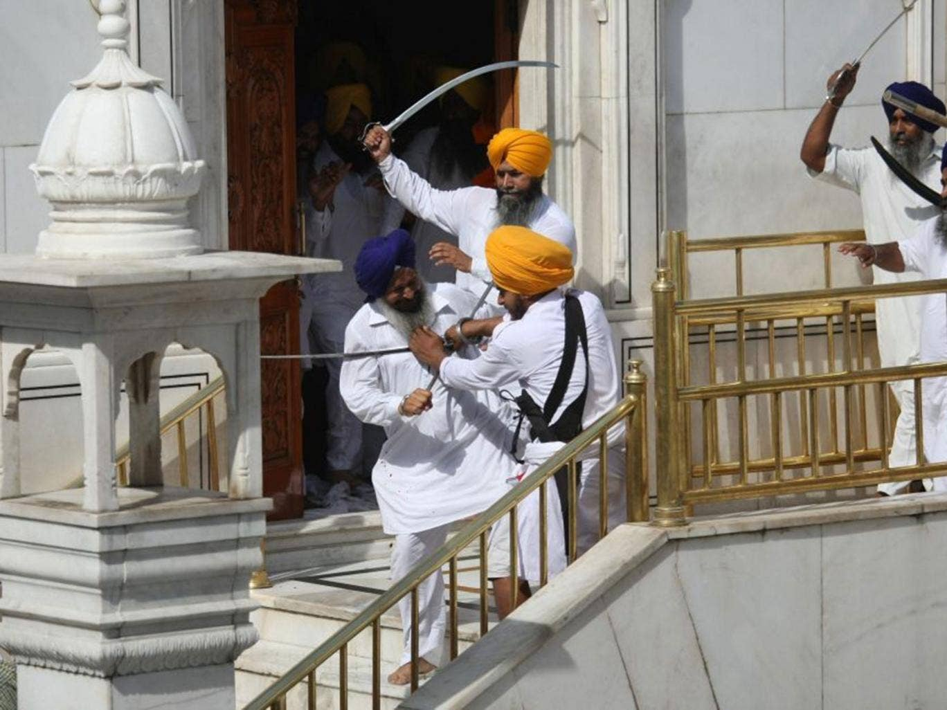 Rival Sikh groups clash outside the Golden Temple at Amritsar