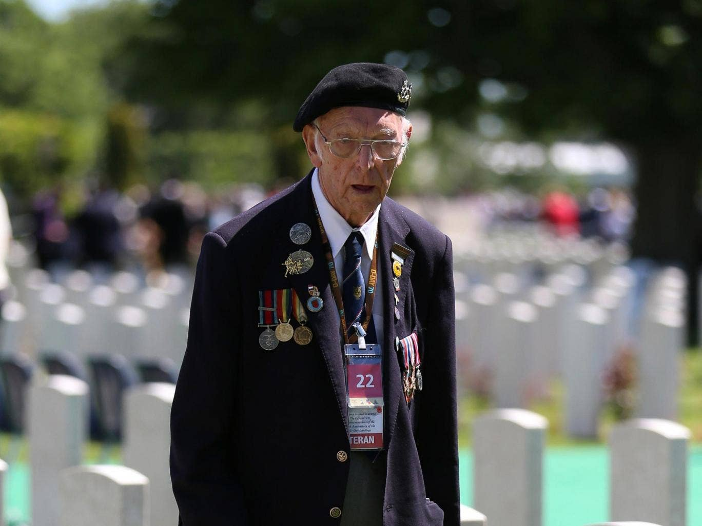 Veteran Bert Banford, 90, in Bayeux Cemetery after the memorial service
