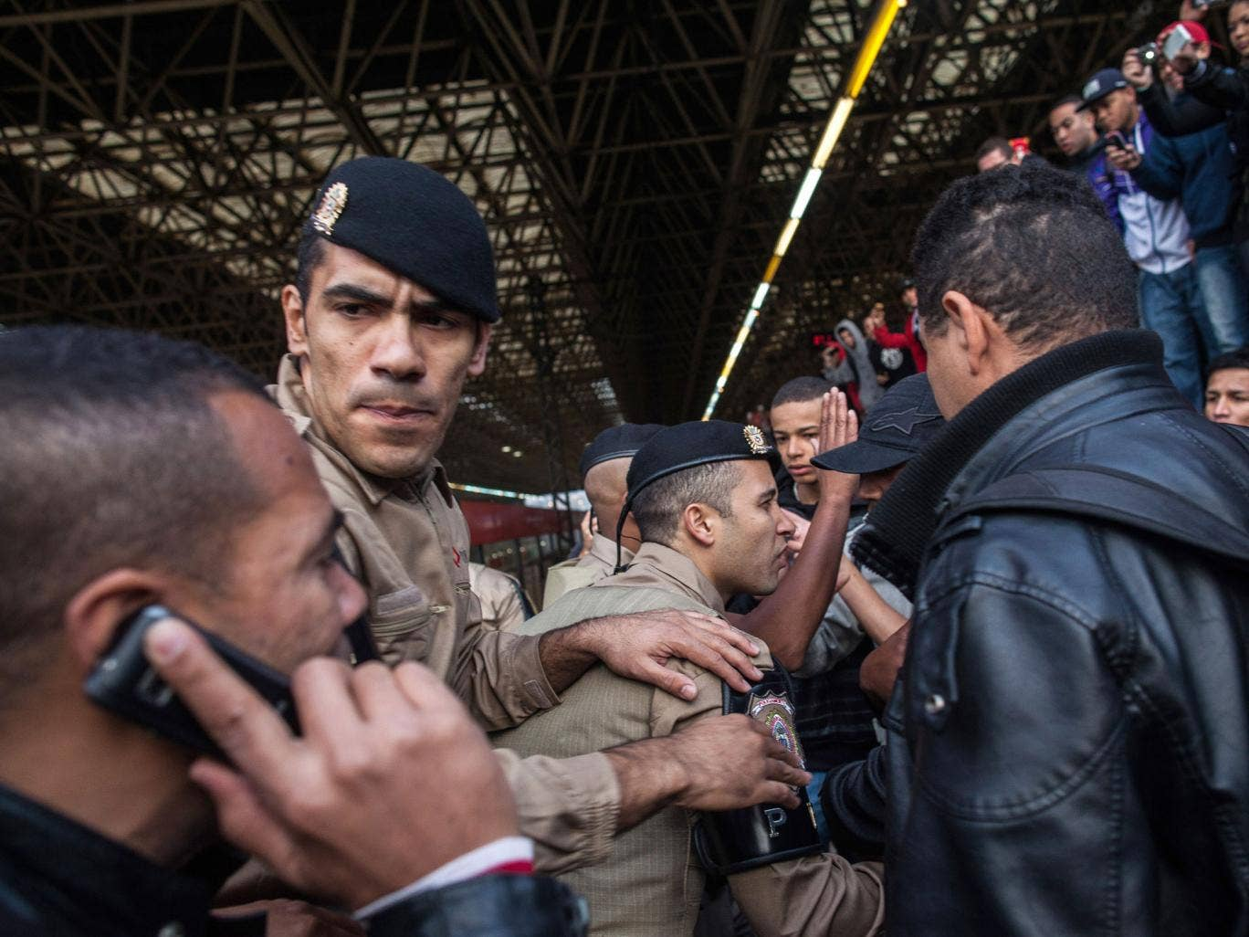 Police and strikers clash after second day of industrial action on Sao Paulo's underground