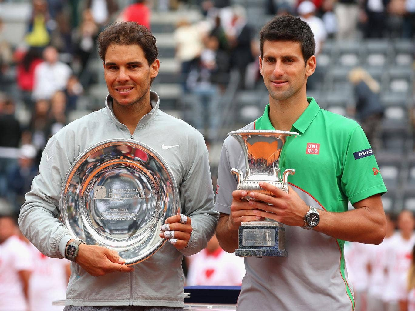 Novak Djokovic of Serbia with the winners trophy next to runner up Rafael Nadal of Spain after the final during day eight of the Internazionali BNL d'Italia