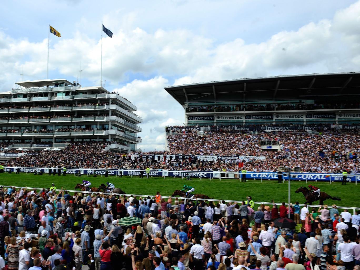 Joseph O'Brien riding Australia win The Investec Derby at Epsom racecourse on June 07, 2014 in Epsom, England.