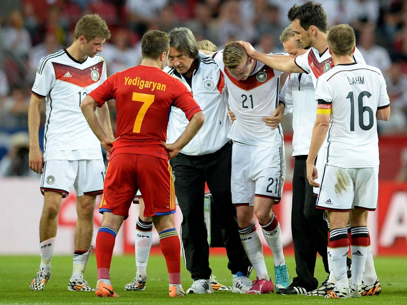 Marco Reus is helped from the pitch after suffering an ankle injury in the friendly between Germany and Armenia