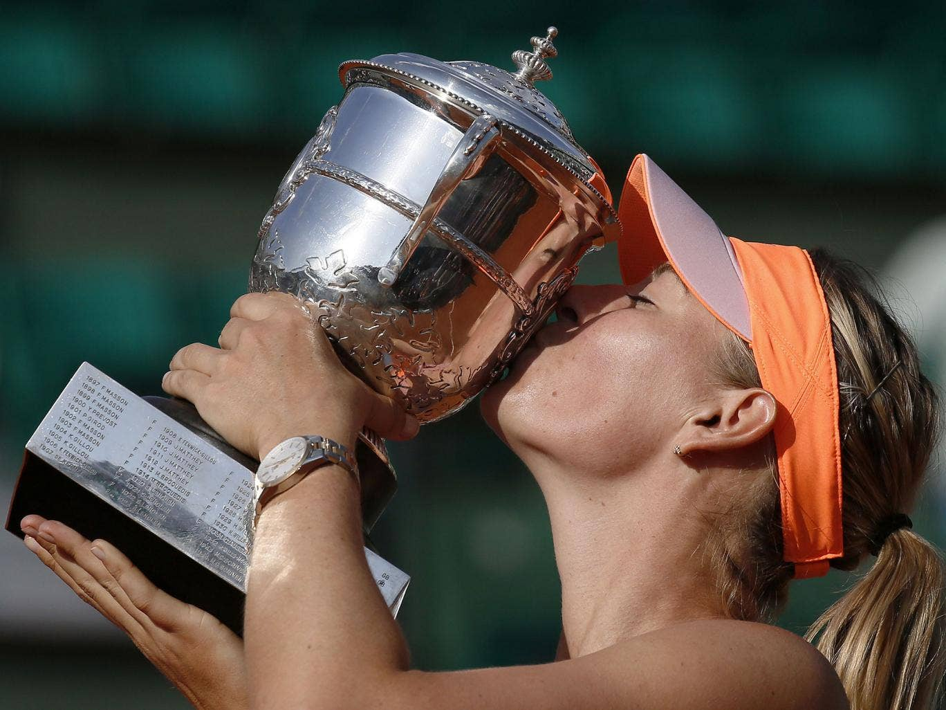 Russia's Maria Sharapova kisses the Suzanne Lenglen trophy after winning her French tennis Open final match against Romania's Simona Halep at the Roland Garros stadium