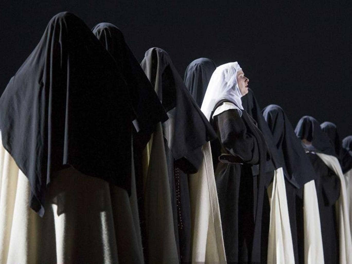 Nuns' story: Sally Matthews and some of the 167-strong cast of Dialogues des Carmélites