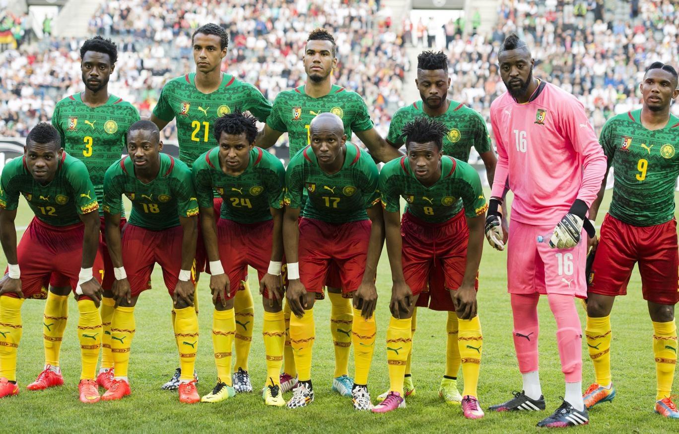 Cameroon's national football team players (1st row, LtoR) Henry Bedimo, Eyong Enoh, Cedric Djeugoue, Stephane Mbia, Benjamin Moukandjou, (2nd row, LtoR) Nicolas N'koulou, Joel Matip, Eric Maxim Choupo-Moting, Alex Song, Charles Itandje, Samuel Eto'o pose