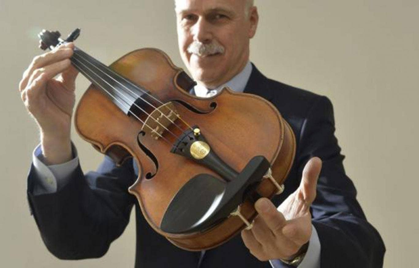 Kerry Keane, Christie's Musical Instruments specialist, poses for a photograph with the Kreutzer Stradivarius violin in London on 9 May, 2014
