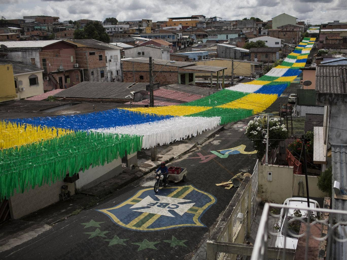 A canopy of ribbons on a street in Manaus