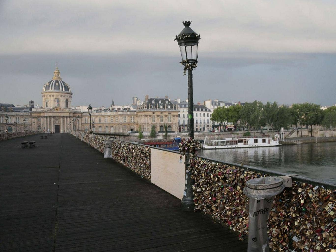 A photo taken on June 9, 2014 shows 'love padlocks' attached to a fence of the Pont des Arts bridge over the Seine river in Paris