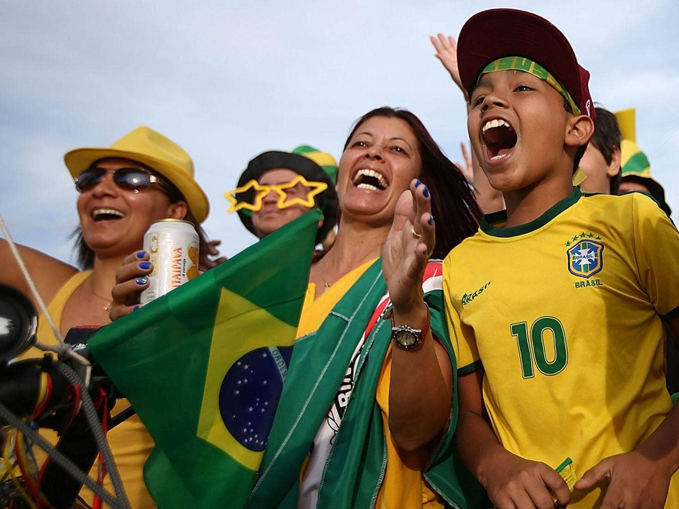 Brazil fans cheer while gathered outside Itaquerao stadium, also known as Arena de Sao Paulo and Arena Corinthians in Sao Paulo