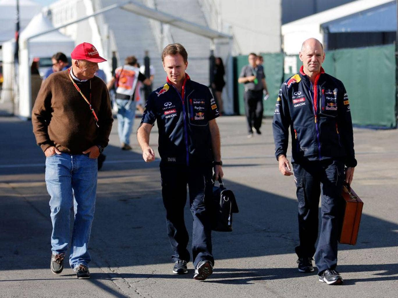 Adrian Newey, far right, will now be allowed to work on design projects involving boats and planes, as well as F1 cars