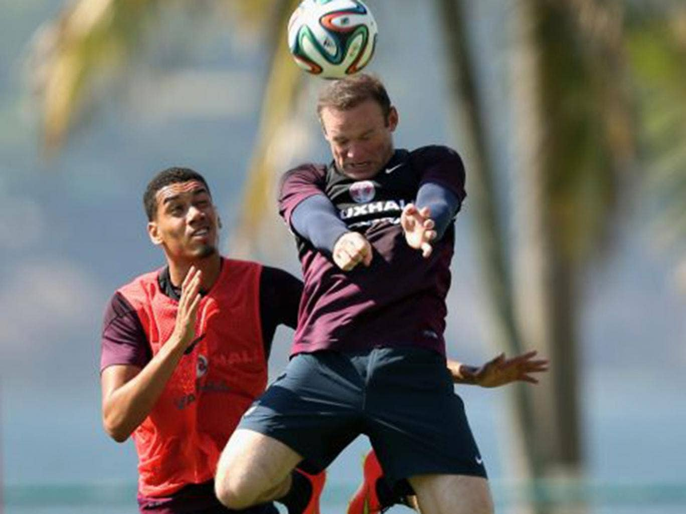 Wayne Rooney outjumps Chris Smalling during England training in Rio