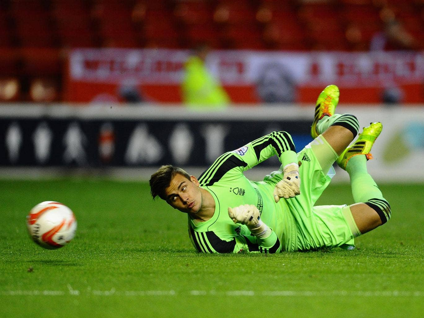 Karl Darlow of Nottingham Forest dives to make a save during the Sky Bet Championship match between Nottingham Forest and Sheffield Wednesday
