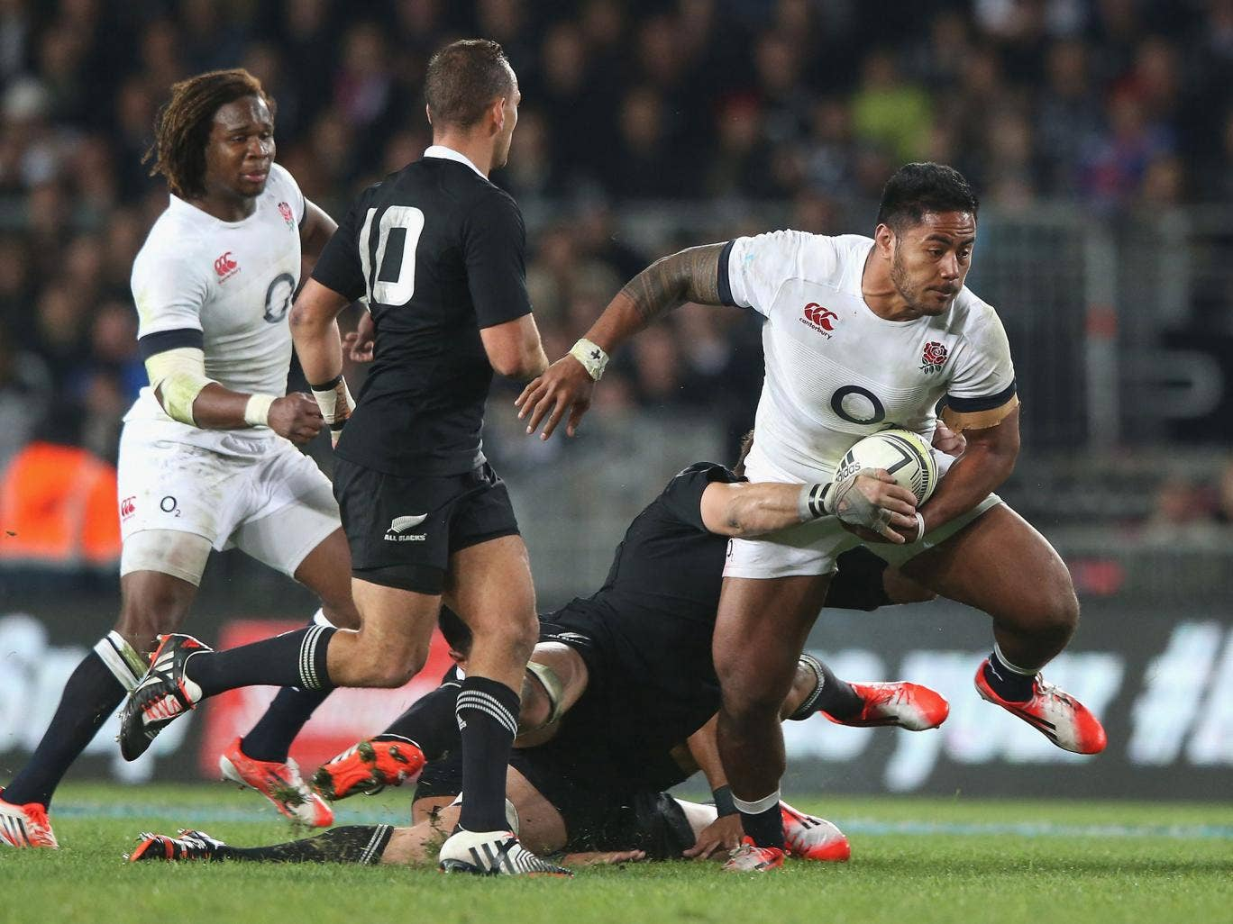 Manu Tuilagi breaks through the New Zealand defence during England's narrow 20-15 defeat