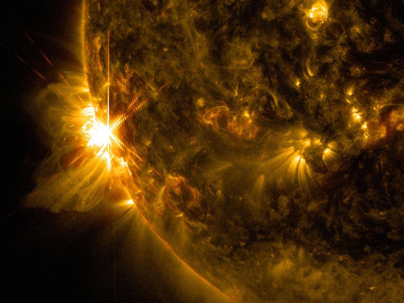 An X2.2 flare solar flare bursts off the left limb of the sun in this image captured by NASA's Solar Dynamics Observatory on June 10, 2014, at 7:41 a.m. EDT. .