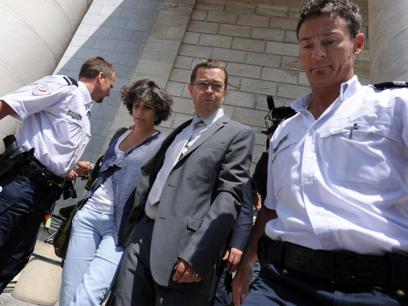 Nicolas Bonnemaison (centre) leaving the Pau courthouse with his wife Julie on the first day of his trial