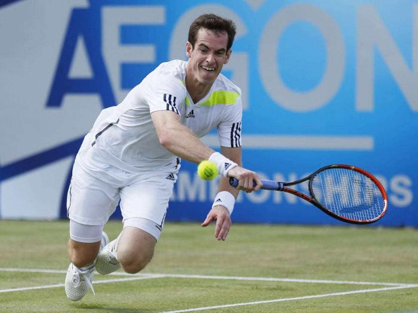 Andy Murray diving to make a shot on his way to a straight-sets victory over the Frenchman, Paul-Henri Mathieu