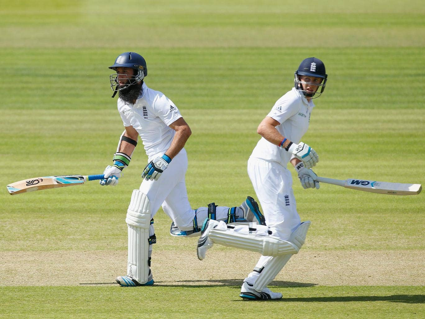 Moeen Ali (L) and Joe Root of England run between the wickets during day one of the 1st Investec Test match between England and Sri Lanka at Lord's