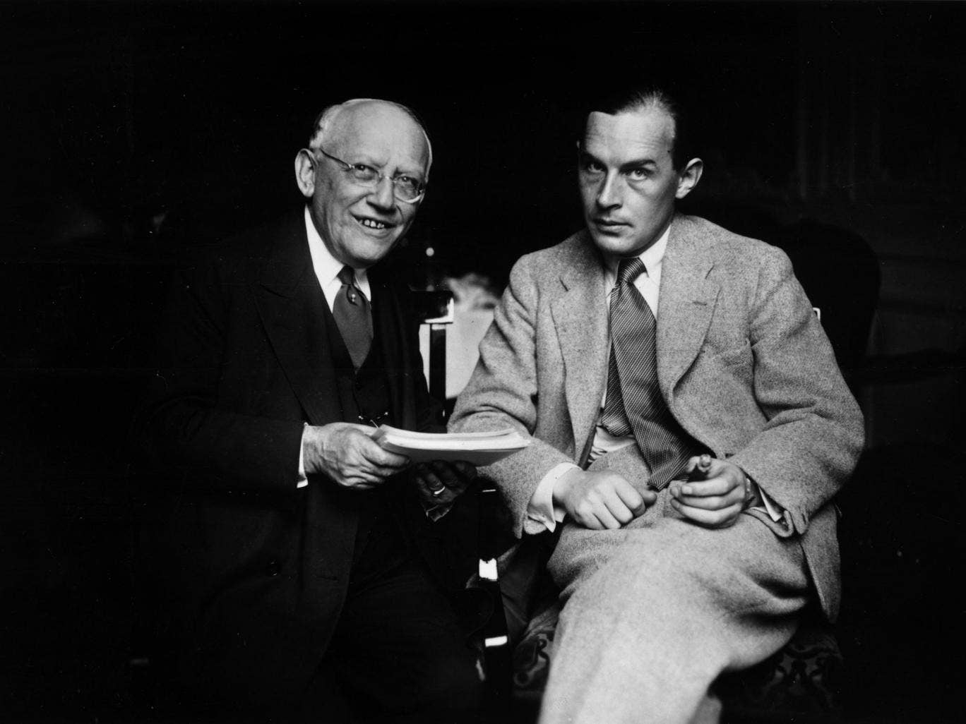 Erich Maria Remarque (1898-1970), whose 1929 novel, 'All Quiet On The Western Front', was based on his wartime experiences. Here he isseen with Carl Laemmle of Universal Pictures (left)