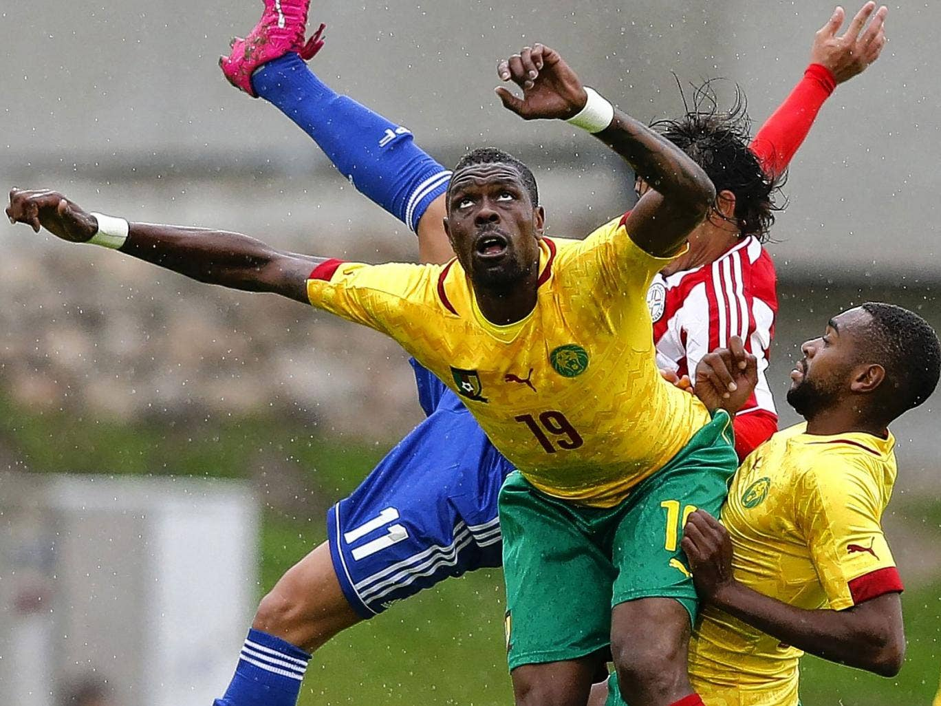 Cameroon's Idrissou Mohammadou (left) in action in a friendly against Paraguay last month