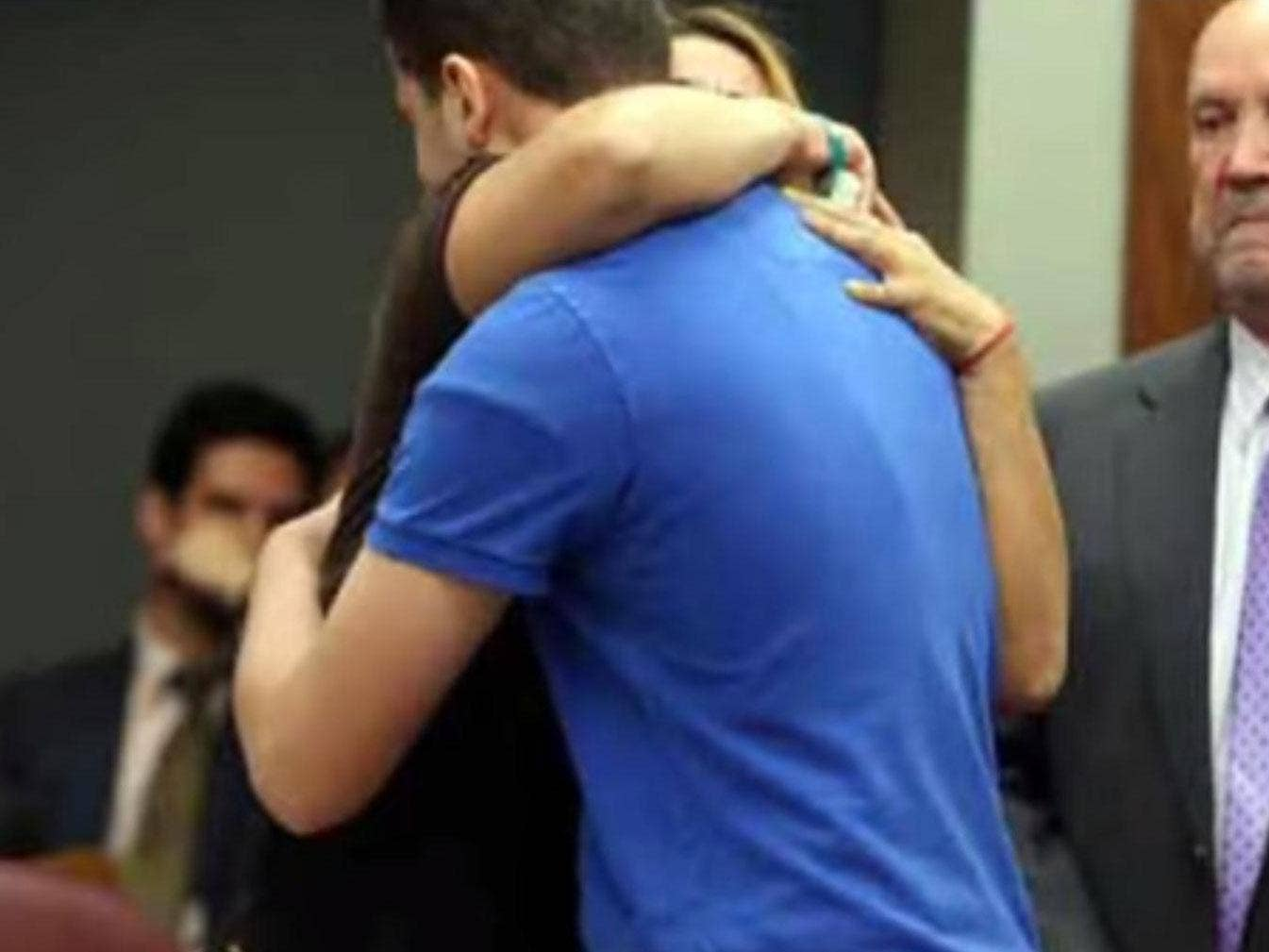 Ady Guzman-DeJesus hugs her daughter's killer, Jordyn Howe, in court.