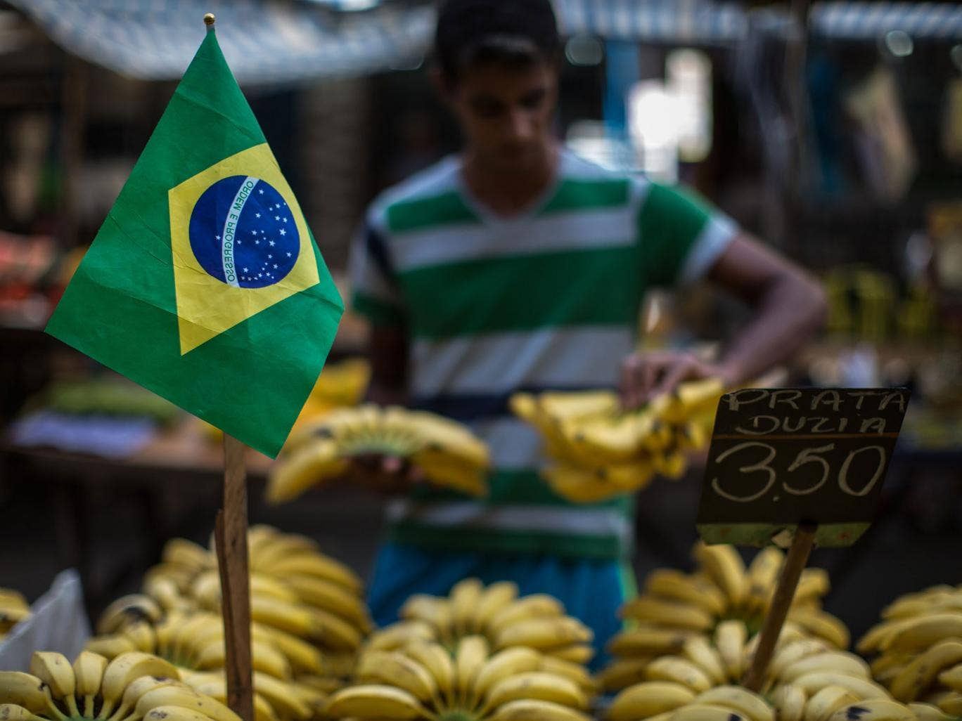 A stallholder sells bananas at Mare complex shantytown (favela) in Rio de Janeiro, Brazil, on June 7, 2014, five days before the start of the FIFA World Cup