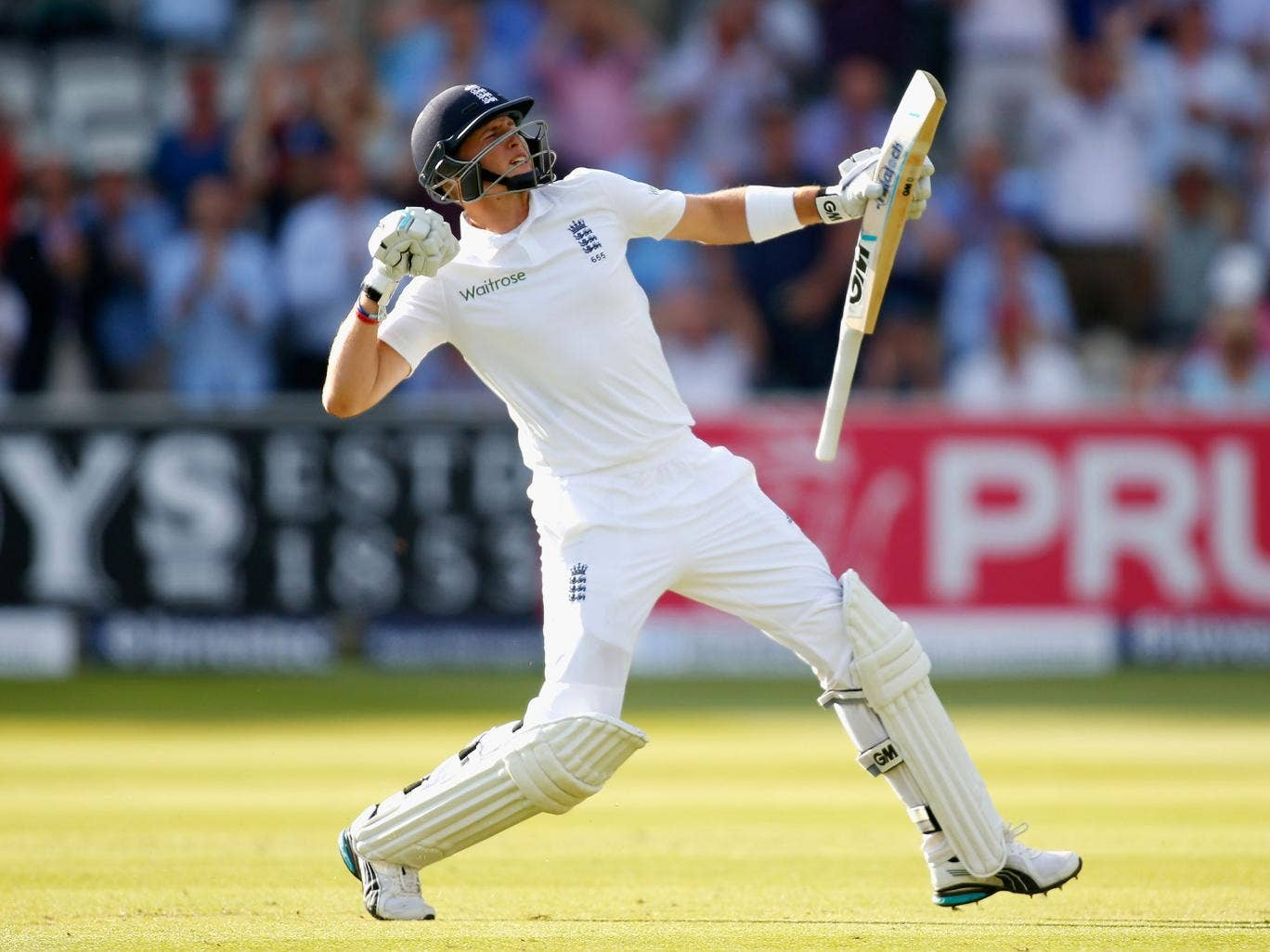 Joe Root of England celebrates reaching his century during day one of the 1st Investec Test match between England and Sri Lanka at Lord's