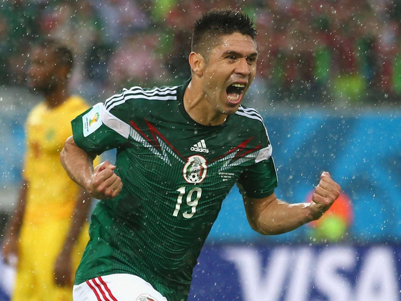Oribe Peralta celebrates his goal for Mexico against Cameroon