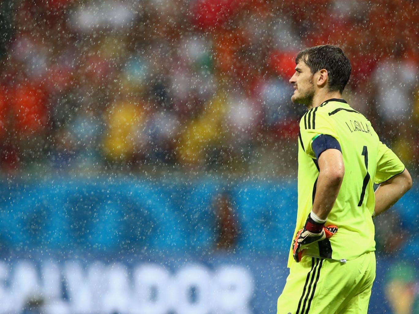 A downbeat Iker Casillas looks on during the heavy defeat in Salvador