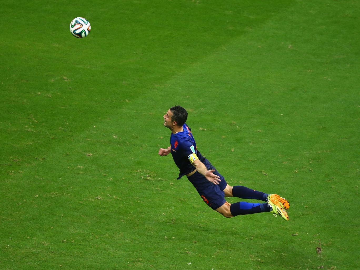 Robin van Persie scores a header in the Netherlands' 5-1 victory over Spain