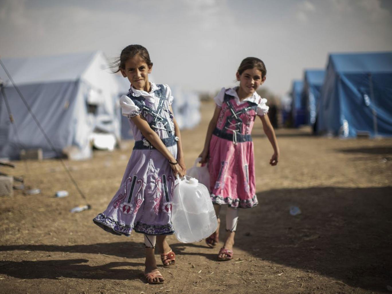 Two Iraqi girls in a temporary camp near the Kurdish region on Friday